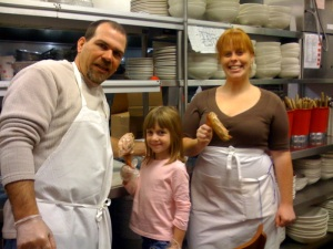 Matt and Sophia with Buca coworker Caroline, carving up the turkeys.